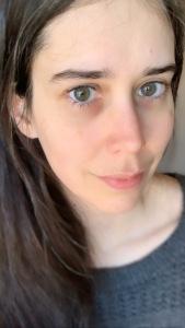 A closeup of Becky wearing her gray InStillness Drop pullover.